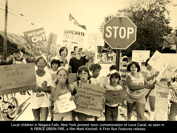 "Kid protesting the Love Canal project. A still from the movie 'A Fierce Green Fire""."